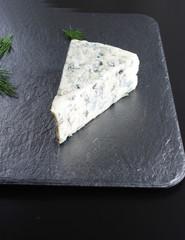 blue cheeseon a dark stone background