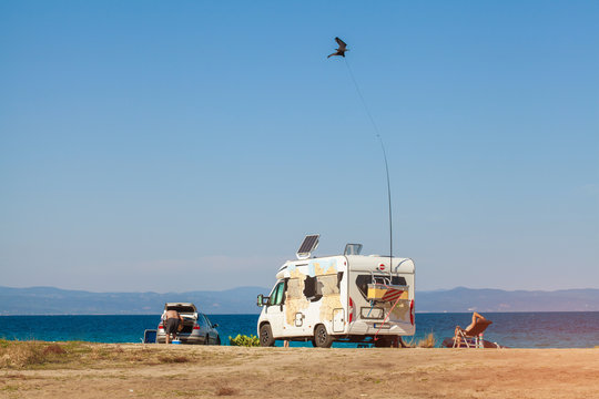 RV camping by the water on a Sunny day. Car with airbrushing on the beach near the sea.