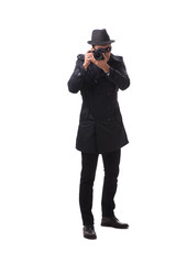 Spy with camera taking pictures isolated on white
