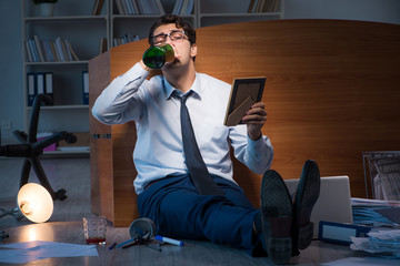 Sad employee in office missing his wife after divorce separation