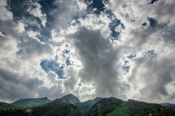 tops of mountains with beautiful clouds