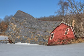 The Sinking Red Barn was located near the Twin Cities in Minnesota before it collapsed in 2017