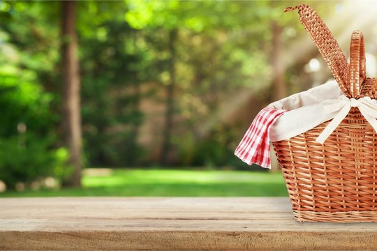 Picnic Basket with napkin on nature background