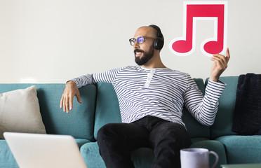 Man enjoying music at home