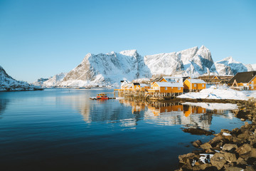 Lofoten winter scenery with traditional fisherman Rorbuer cabins, Sakrisoy, village of Reine, Norway