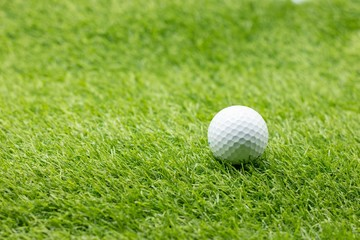 Golf ball is on green grass