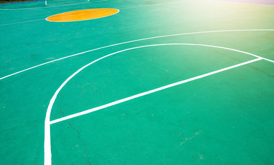 basketball court green color and white line, photo on top view by drone.