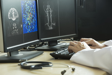 Doctor using computer in medical office