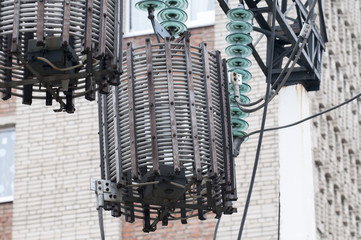 Line traps, also called wave traps, suspended under a high voltage power line pylon.