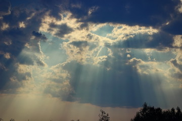 rays of light through thunderclouds