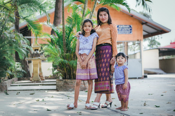 happy family in thai suit thailand style