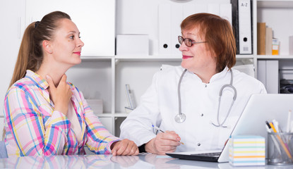Young mother talking with doctor about health
