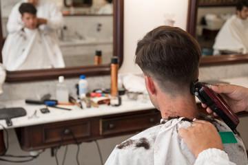 Barber shaving a customer with razor