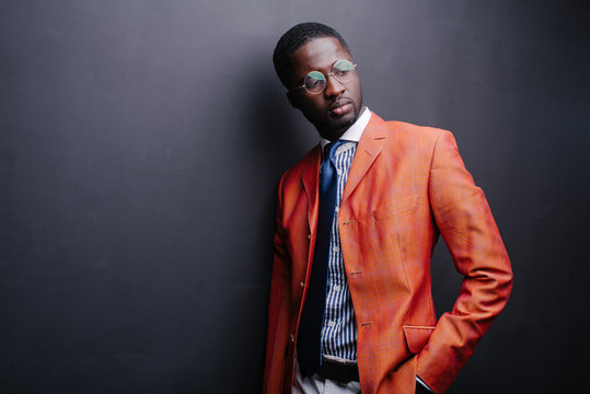 Studio fashion portrait of a handsome young African American businessman
