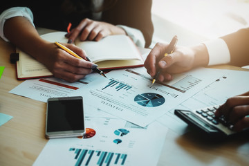 Financial advisor, accounting and Investment concept, business owners consult adviser financial meeting to analyze and  on the finance report in the his office room.
