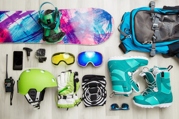 Photo of snowboarder objects on wooden background.