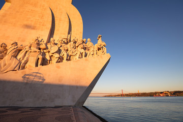 Lisbon, Portugal - August 3, 2017: Lisbon waterfront brdige and the Monument to the Discoveries