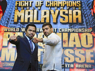 "Pacquiao and Matthysse attend a news conference for their upcoming WBA ""regular"" welterweight title fight, in Paranaque city, metro Manila"