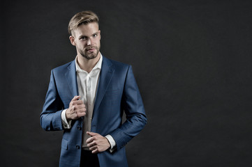Manager in formal outfit. Man in blue suit jacket and shirt. Businessman with beard and stylish hair. Fashion, style and dress code. Business, entrepreneurship and career concept, vintage, copy space