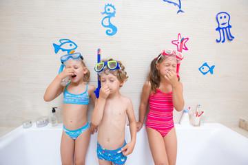 Children play in the bathroom