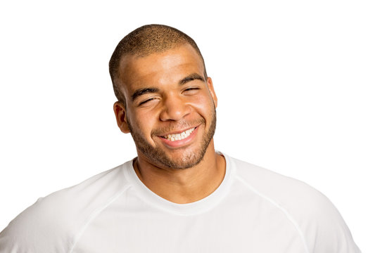 Cute black young man laughing, isolated on white background
