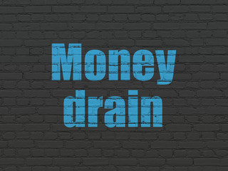 Money concept: Painted blue text Money Drain on Black Brick wall background