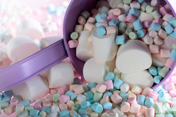 Violet pail with various marshmallows.