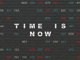 Time concept: Painted white text Time is Now on Black Brick wall background with Hexadecimal Code