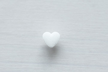 White heart on a white background. Design with copy space. Top view