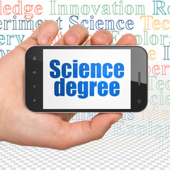 Science concept: Hand Holding Smartphone with  blue text Science Degree on display,  Tag Cloud background, 3D rendering