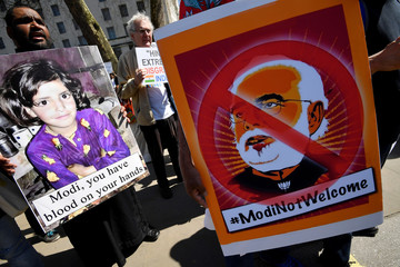 Demonstrators stage a protest against the visit by India's Prime Minister Narendra Modi opposite Downing Street in London