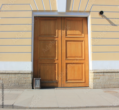 Wooden Door On Old Historic Building Facade Street View With Simple