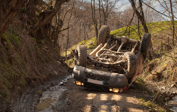 Offroad rollover accident, car flipped on mountain road