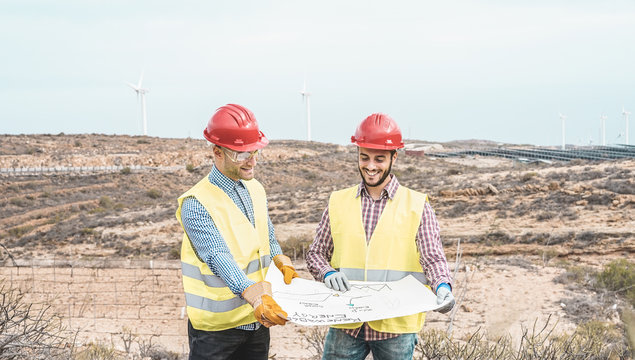 Workers engineers discussing renewable energy project
