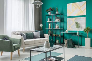 Bright sofa in green room