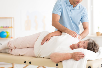 Physiotherapy of old woman