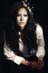 Girl with a stylized make-up of a dead bride