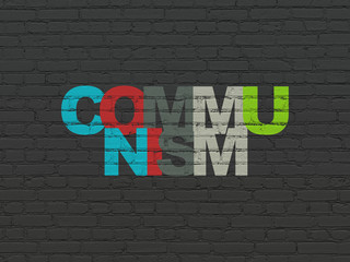Politics concept: Painted multicolor text Communism on Black Brick wall background
