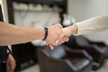 People shaking hands at hairdresser salon