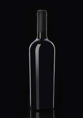 Bottle of red wine on black background