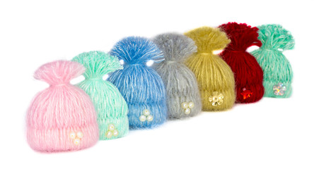 seven beautiful multi-colored caps -. handmade brooches lined up waiting for the lucky owners