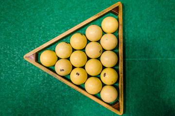 Triangle of balls on the green cloth. Russian billiard. Top view