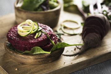 beet burgers on a wooden table