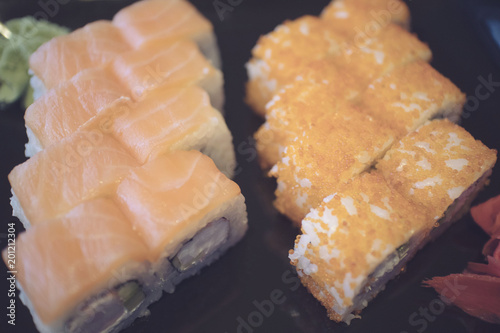 Delicious Sushi Roll With Salmon Raw Shrimp Eggs And Sesame With