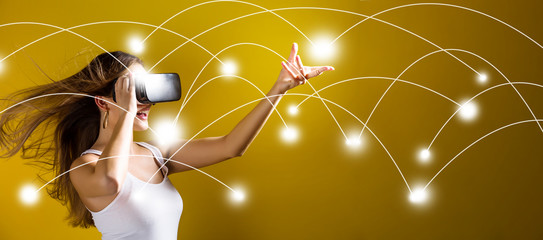 Network and connection technology concept with young woman using a virtual reality headset