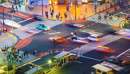 Traffic crosses a busy intersection in Shibuya, Tokyo, Japan