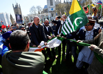 Protesters rip up India's flag after tearing it off a flagpole in Parliament Square, London