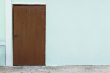 oak wood door in white concrete wall background