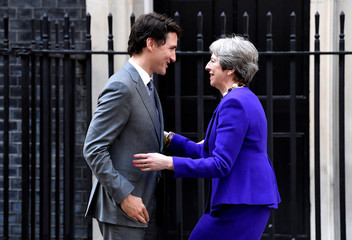 Britain's Prime Minister Theresa May welcomes Canada's Prime Minister Justin Trudeau to 10 Downing Street in London