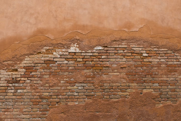 Old cracky brick wall with crumble paint and cement background in Italy, Venice